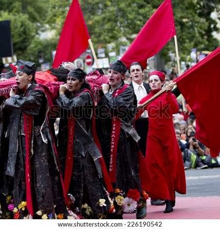 AURILLAC, FRANCE-AUGUST 22: red flags and emotion for the Lenin funeral as part of the Aurillac International Street Theater Festival, cie teatro del silencio there august 22, 2014 in Aurillac,France. - stock photo