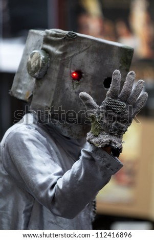AURILLAC, FRANCE - AUGUST 24: The head of a robot is on the asphalt as part of the Aurillac International Street Theater Festival, show Robot Nozomi, on august 24, 2012, in Aurillac,France. - stock photo