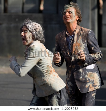 AURILLAC, FRANCE - AUGUST 22: very dirty and worrying actors in the street as part of the Aurillac International Street Theater Festival, Company n�°8 ,on august 22, 2012, in Aurillac,France. - stock photo