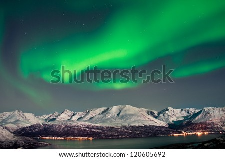 Aurora above fjords in Norway - stock photo