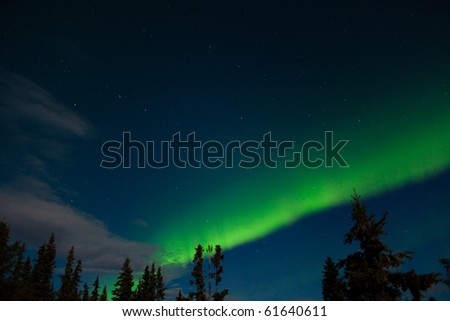 "Aurora borealis (northern lights) and lots of stars around the constellation ""Big Dipper"". - stock photo"