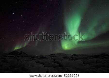 Aurora Borealis over the Arctic - stock photo