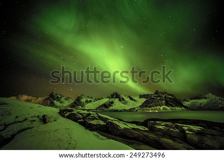 Aurora borealis (Polar lights) over the mountains in the North of Europe - Steinfjord, Lofoten islands, Norway - stock photo