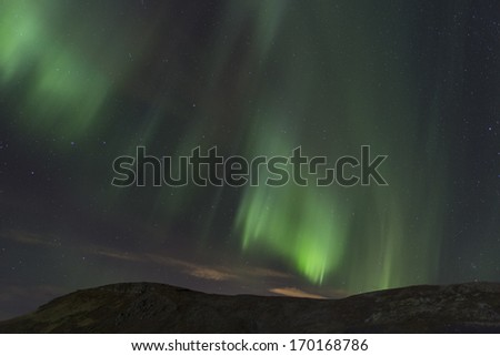 Aurora coming over the hill - stock photo