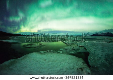 Aurora dancing over the Jokulsarlon lagoon, Iceland - stock photo