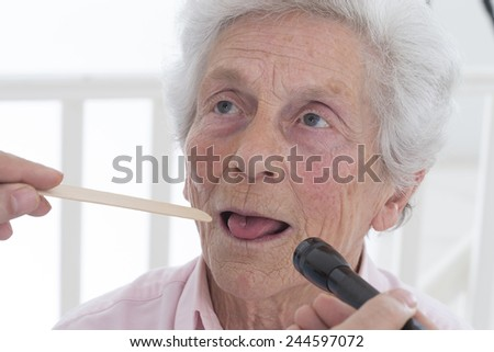 auscultation senior tongue depressor - stock photo