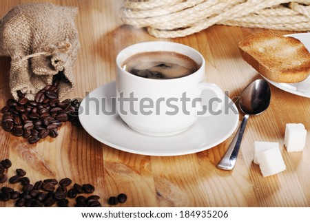 austere morning breakfast: hot coffee with toast - stock photo