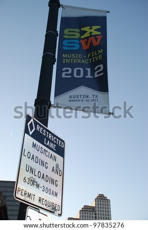 AUSTIN - CIRCA MARCH 2012: Musician parking sign during South by Southwest festivities Austin, Texas SXSW 2012. - stock photo