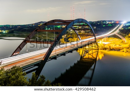AUSTIN - CIRCA OCTOBER 2016: Cars drive over the Pennybacker bridge at night in Austin, Texas. The bridge is often called the 360 bridge by locals for its circular shape.