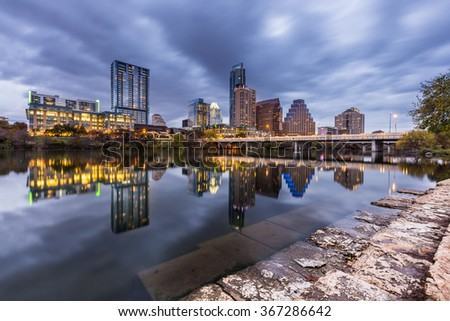 Austin downtown skyline by the river at night, Texas. - stock photo