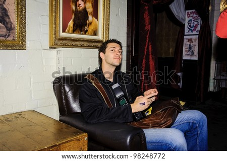 AUSTIN - MARCH 22: An unidentified patron rests while at The Mohawk on March 22, 2012 in Austin, Texas. The Mohawk is located near the SXSW venue. - stock photo