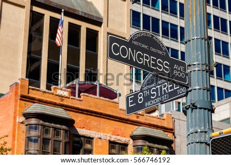 Austin, Texas cityscape with street signs in the historic district.