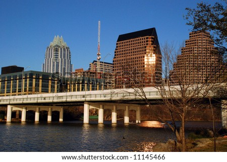 Austin, Texas downtown skyline at sunset, embraced by the beauty of Lady Bird Lake. - stock photo