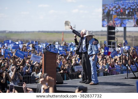 AUSTIN, TEXAS - FEBRUARY 27, 2016: Bernie Sanders is greeted by Jim Hightower upon his arrival at a campaign rally at the Circuit of the Americas. - stock photo