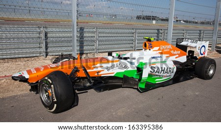 AUSTIN, TEXAS - NOVEMBER 17. Adrian Sutil of Force India's crashed car siting off the track during the Formula 1 United States Grand Prix on November 17, 2013 in Austin, Texas. - stock photo