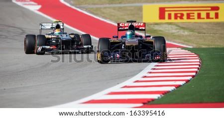 AUSTIN, TEXAS - NOVEMBER 17. Esteban Gutierrez of Team Sauber trailing Team Toro Rosso during the Formula 1 United States Grand Prix on November 17, 2013 in Austin, Texas. - stock photo