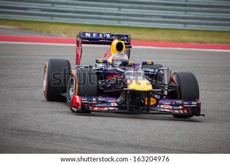 AUSTIN, TEXAS � NOVEMBER 16.  Team Red Bull races in the Formula One Qualifying Session at the Circuit of the America's race track on November 16, 2013 in Austin, Texas. - stock photo
