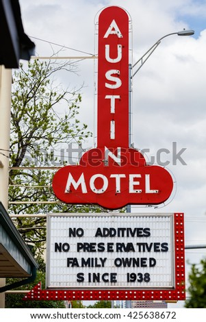 Austin, Texas USA - April 10, 2016: The colorful red sign of the classic Southwestern style Austin Motel located on Congress Avenue near downtown.