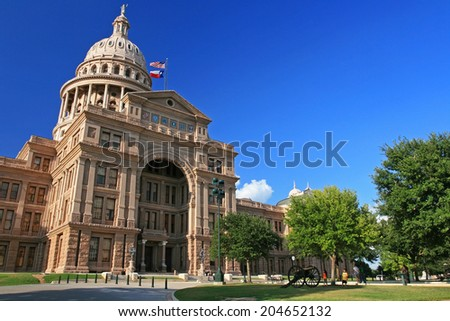 AUSTIN,TEXAS, USA -JULY 19, 2008: Unidentified people visit Texas state capitol. Capitol has 360,000 square ft. of floor space, more than other state capitol buildings. - stock photo