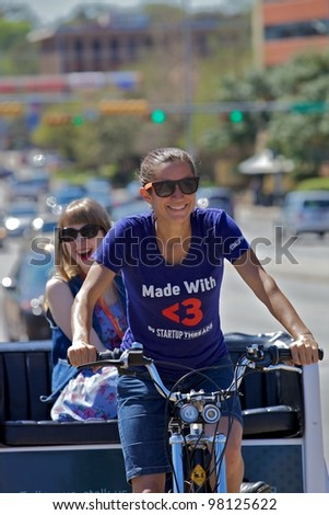 Austin, TX - March 12: SXSW Interactive Conference in Austin.   Austin Pedicabs are in high demand during the conference - stock photo