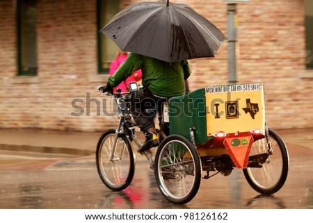 Austin, TX - March 9: SXSW Interactive Conference in Austin.   Rain does not slow down the SXSW conference. - stock photo