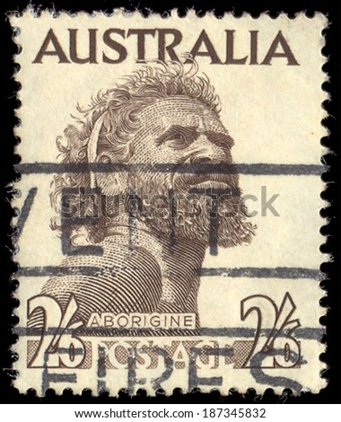 AUSTRALIA - 1952: An Australian postage stamp with an image of an Aborigine, circa 1952  - stock photo