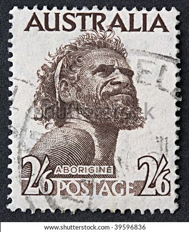 AUSTRALIA - 1952: An Australian postage stamp with an image of an Aborigine, circa 1952 - stock photo