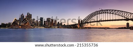 australia capital city Sydney view on CBD landmarks harbour, bridge and skyscrapers at sunset with hot-blue sky panoramic view - stock photo