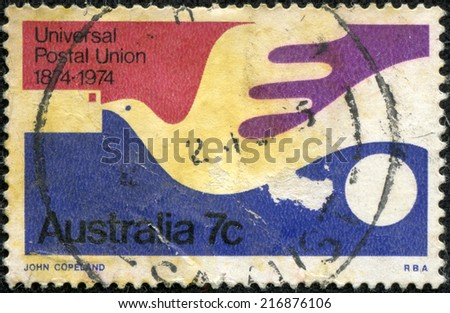 AUSTRALIA - CIRCA 1974:A Cancelled postage stamp from Australia illustrating Centenary of Universal Postal Union, issued in 1974. - stock photo