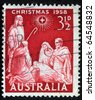 AUSTRALIA - CIRCA 1958 : A greeting Christmas stamp printed in Australia shows birth of Jesus Christ, circa 1958 - stock photo