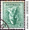 AUSTRALIA - CIRCA 1937: A stamp printed in Australia shows a koala, circa 1937. - stock photo