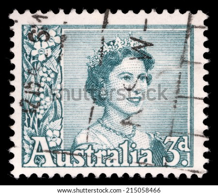 AUSTRALIA - CIRCA 1959: A stamp printed in Australia shows a portrait of Queen Elizabeth II, circa 1959. - stock photo