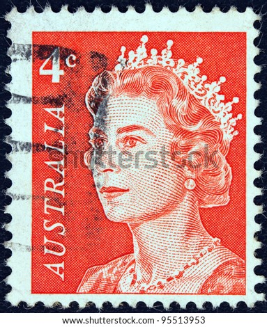 AUSTRALIA - CIRCA 1966: A stamp printed in Australia shows a portrait of Queen Elizabeth II, circa 1966. - stock photo