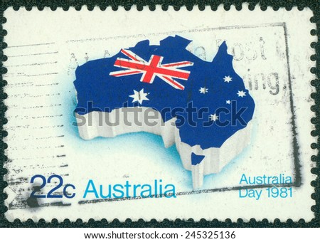 AUSTRALIA - CIRCA 1981: A stamp printed in Australia shows flag of Australia placed in the contour of the continent, circa 1981 - stock photo