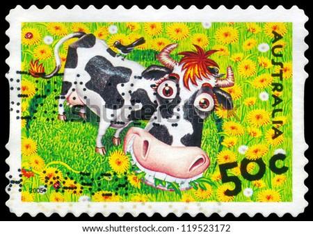 AUSTRALIA - CIRCA 2005: A stamp printed in AUSTRALIA shows the Cow and Bird, Down on the Farm series, circa 2005 - stock photo