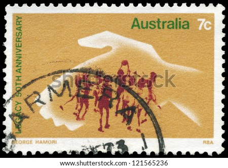 AUSTRALIA - CIRCA 1973: A Stamp printed in AUSTRALIA shows the Hand protecting playing Children, 50th anniversary of Legacy, an ex-servicemens organization, circa 1973 - stock photo