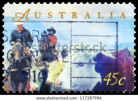 AUSTRALIA - CIRCA 1998: A Stamp printed in AUSTRALIA shows the Herding Cattle on Horseback, Farming series, circa 1998 - stock photo
