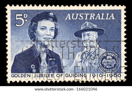 AUSTRALIA - CIRCA 1960: a stamp printed in the Australia shows Girl Guide and Lord Baden-Powell, 50th Anniversary of the Girl Guides, circa 1960 - stock photo