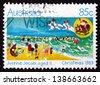 AUSTRALIA - CIRCA 1983: a stamp printed in the Australia shows Holiday Beach Scene, Design by Justine Jacobi, Aged 11, Christmas, circa 1983 - stock photo