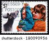 AUSTRALIA - CIRCA 1987: a stamp printed in the Australia shows Playing with a Joey, Children, circa 1987 - stock