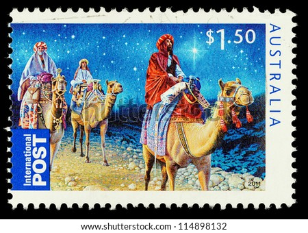 AUSTRALIA - CIRCA 2011: An Australian Used Christmas Postage Stamp showing the Three Kings riding on Camels, circa 2011 - stock photo