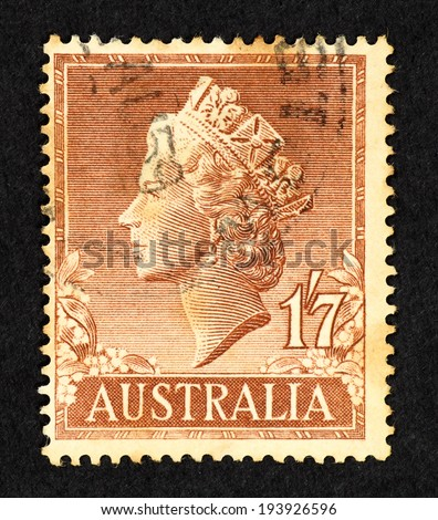 AUSTRALIA - CIRCA 1955: Brown color postage stamp printed in Australia with image of Queen Elizabeth II head.
