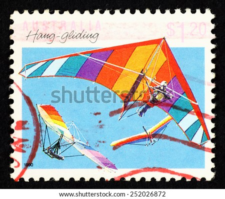 AUSTRALIA - CIRCA 1990: Postage stamp printed in Australia with image of hang gliders in the sky.  - stock photo