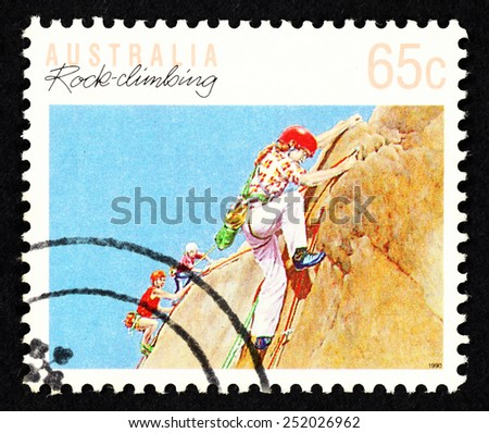 AUSTRALIA - CIRCA 1990: Postage stamp printed in Australia with image of rock climber on a rock surface.  - stock photo