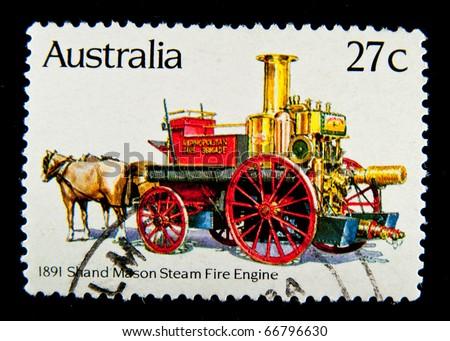 AUSTRALIA - CIRCA 1983: stamp printed by Australia, shows Historic Fire Engines, circa 1983 - stock photo