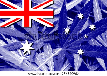 Australia Flag on cannabis background. Drug policy. Legalization of marijuana - stock photo