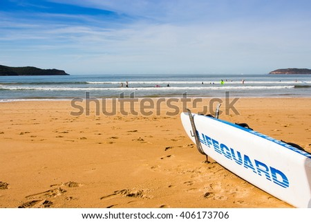 Australia Lifeguard  surf board front of the ocean. - stock photo