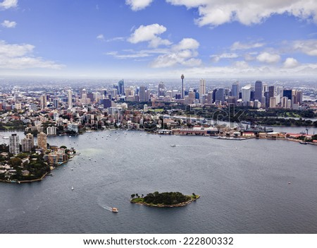 Australia NSW Sydney CBD and suburbs with harbour and small island aerial view from helicopter summer day time - stock photo