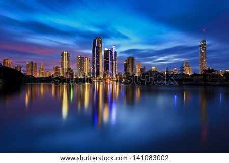 Australia Queensland Gold Coast Surfers Paradise CBD city at sunrise reflection of vivid lights in still water - stock photo