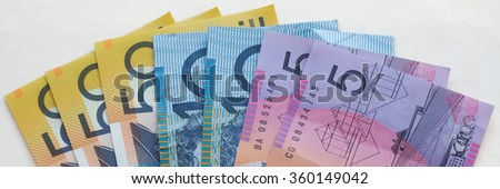 Australian Bank Notes A variety of bank notes from Australia - fifty dollar notes, ten dollar notes and five dollar notes. - stock photo